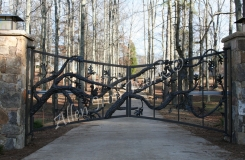 hand-forged-unique-iron-driveway-gate-birmingham-al-with-nature-logs-oak-leaves-squirrels