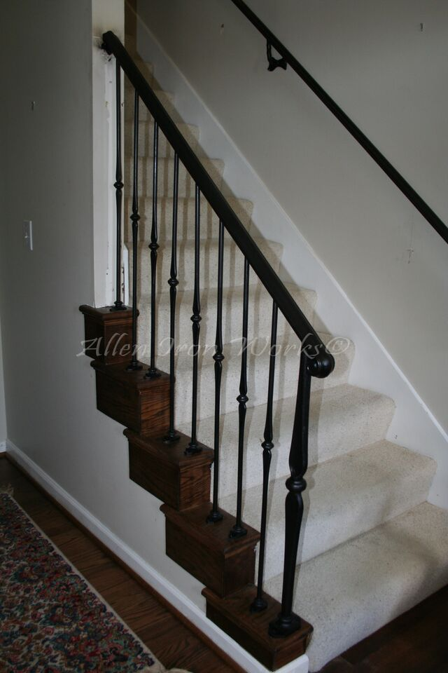Iron Interior Railing With Decorative Forged Picket Anchored